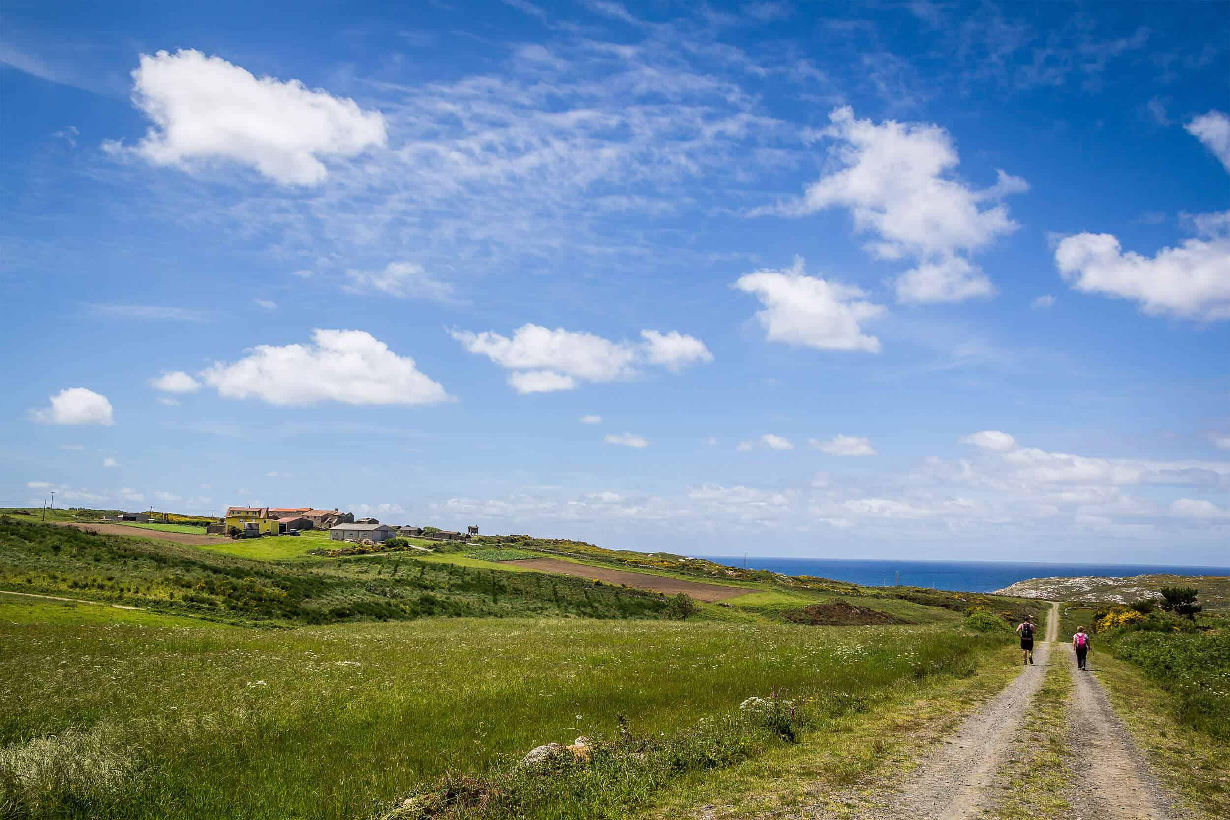Pilgrim walking camino finisterra - end of the world toward sea