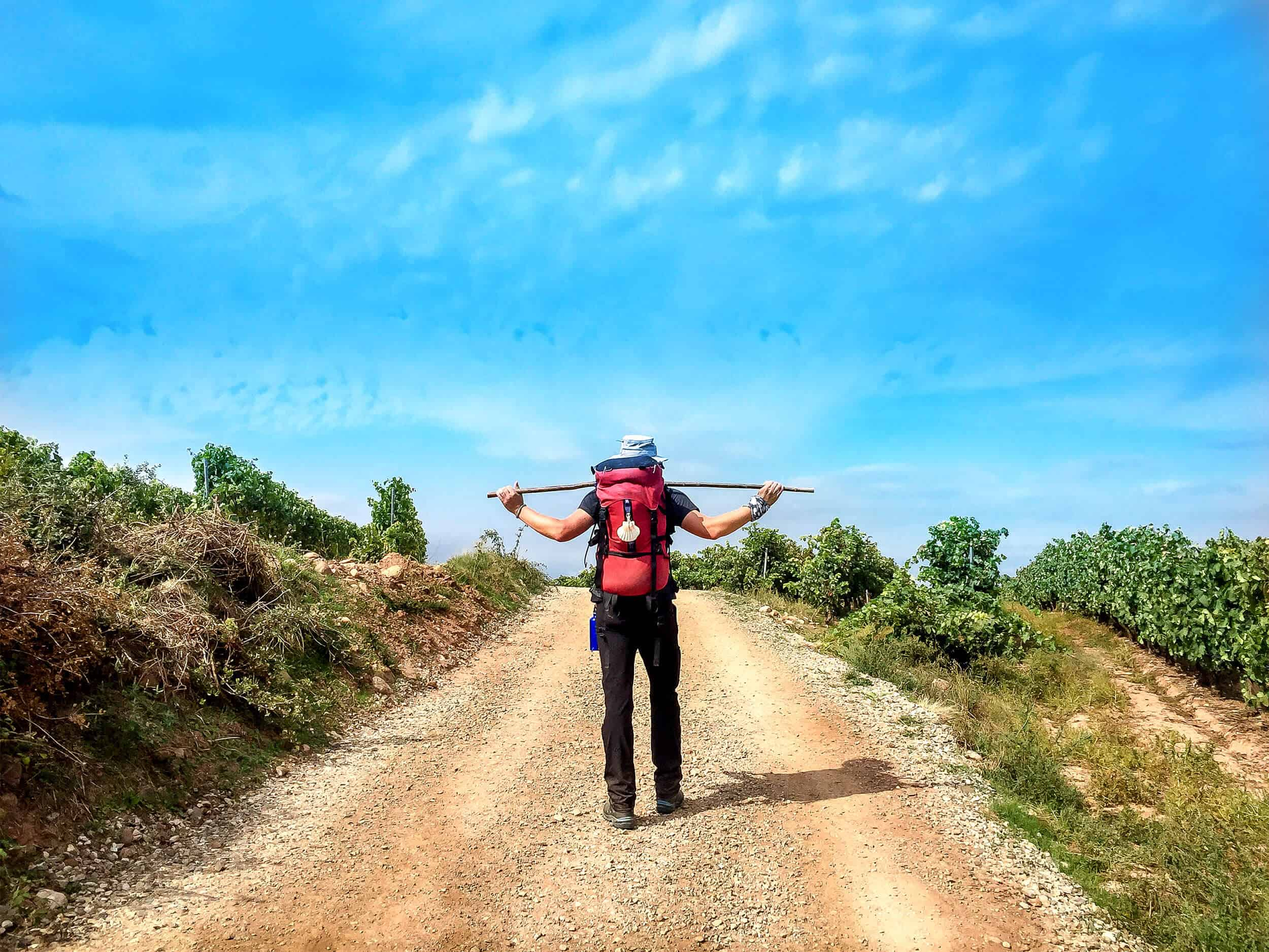A man stretching on the Camino route in Spain