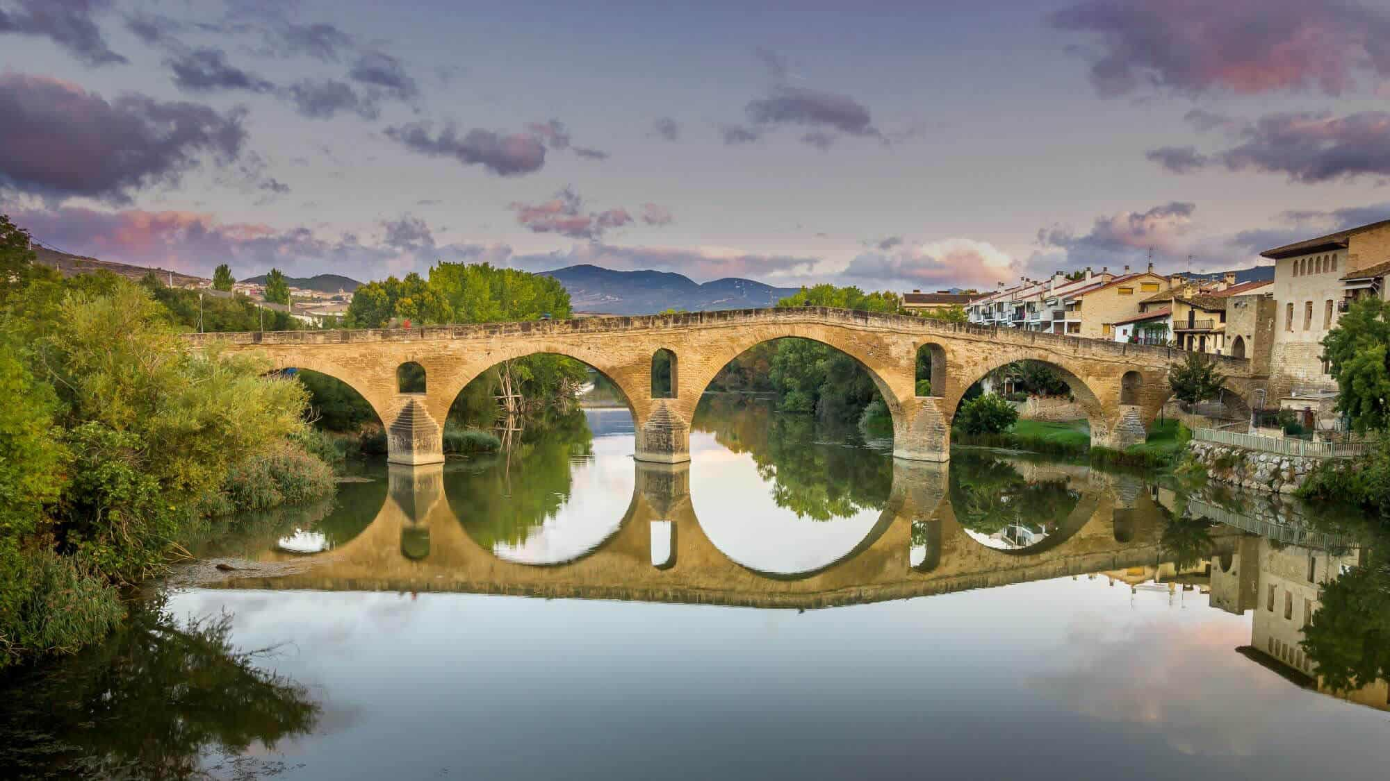 Puente la Reina bridge reflection from the water along the Camino route in France